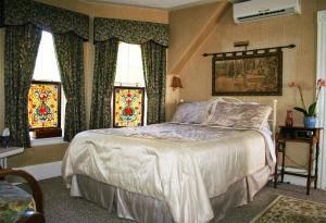 A bed or beds in a room at A Boat to Sea Bed & Breakfast