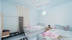 A bed or beds in a room at Sand Beach House - breathtaking view, and amazing position directly opposite the beach!