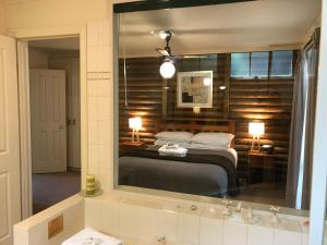 A bed or beds in a room at Ti-Tree Village