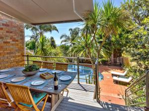 A view of the pool at The Palms Holiday House Mt Martha or nearby