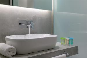 Een badkamer bij Avra Beach Resort