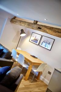 A seating area at Brewery House By Flying Butler
