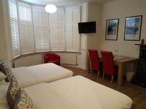 A bed or beds in a room at Archways Lodge Hotel