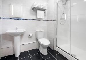 A bathroom at The Ripley Court Hotel