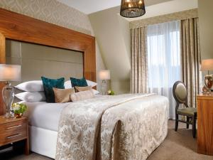 A bed or beds in a room at Carrigaline Court Hotel & Leisure Centre