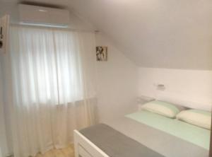 Postel nebo postele na pokoji v ubytování Guesthouse Abrlic