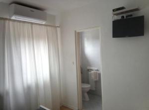 TV a/nebo společenská místnost v ubytování Guesthouse Abrlic