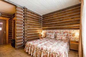 Кровать или кровати в номере Загородный комплекс Ранчо 636