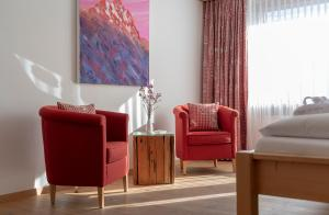 A seating area at Hotel Alpina