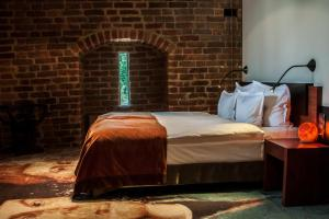 Кровать или кровати в номере Hotel Krasicki