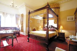 A bed or beds in a room at Cotford Hotel