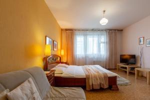 Кровать или кровати в номере 111- Мосфлэт- Москва