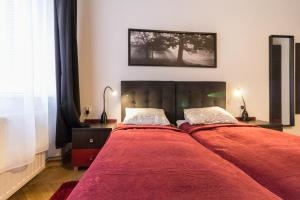 Posteľ alebo postele v izbe v ubytovaní Nowy Kleparz
