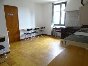 A kitchen or kitchenette at Albergue Convento Del Camino