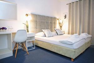 Cama o camas de una habitación en Hotel Delfin