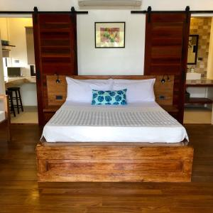 A bed or beds in a room at The Village Siargao