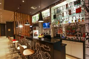 The lounge or bar area at Ibis Sinop