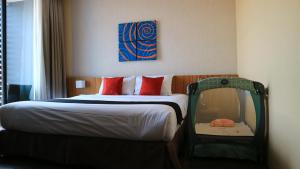 A bed or beds in a room at Apo Hotel