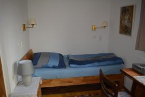 Ein Bett oder Betten in einem Zimmer der Unterkunft Thölkes Hus