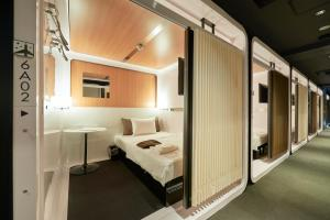 A bed or beds in a room at First Cabin Tokyo Dome City
