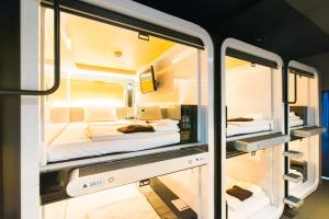 A bunk bed or bunk beds in a room at First Cabin Tokyo Dome City