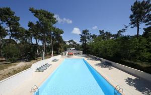 The swimming pool at or near Arc en Ciel Oléron
