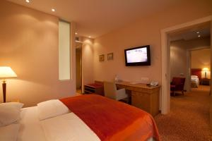 A bed or beds in a room at Amber Spa Boutique Hotel
