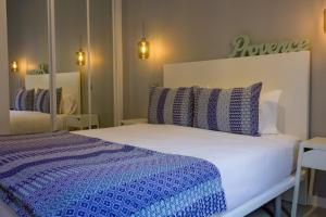 A bed or beds in a room at Arenal Suites Puerta del Sol