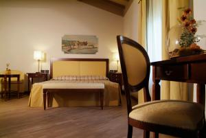 A bed or beds in a room at Relais Corte Cavalli