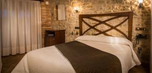 Cama o camas de una habitación en Hotel El Castell