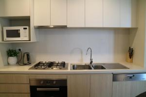 A kitchen or kitchenette at Cozy Family Home+ Parking, Close to Train Station