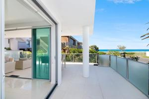 A balcony or terrace at Golden Four Drive - Luxury Four Bedroom Apartment with private plunge pool
