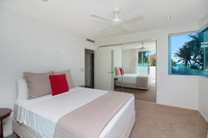 A bed or beds in a room at Golden Four Drive - Luxury Four Bedroom Apartment with private plunge pool