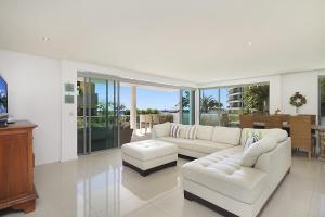 A seating area at Golden Four Drive - Luxury Four Bedroom Apartment with private plunge pool