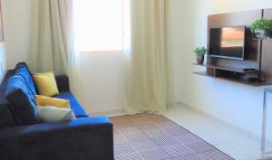 A television and/or entertainment center at Apartamento aconchegante na região central de Cuiabá