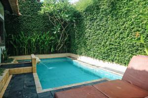 The swimming pool at or close to Kuta Lagoon Resort and Pool Villas