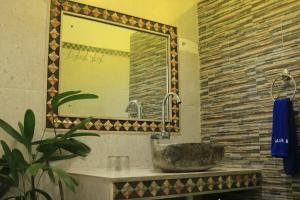 Salle de bains dans l'établissement Alur Beach Homestay