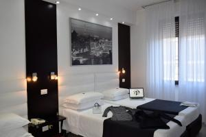 A bed or beds in a room at Hotel Perugino