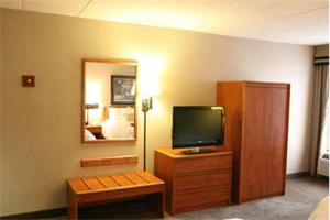 A television and/or entertainment center at Hampton Inn Columbus/Taylorsville