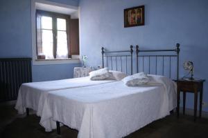 A bed or beds in a room at La Casetta - Casa di Campagna