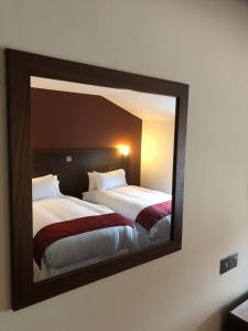 A bed or beds in a room at Scone Arms