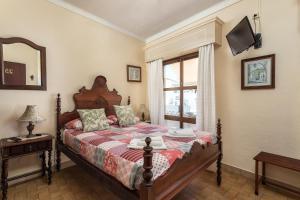 Cama o camas de una habitación en AL - Alojamento Local Pension Bicuar