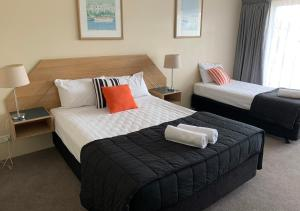 A bed or beds in a room at Outrigger Burleigh
