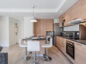 A kitchen or kitchenette at Appart Coeur de Lyon - Part Dieu - Paul Bert