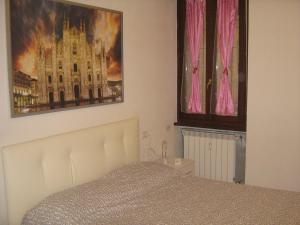 A bed or beds in a room at Flat in Milan 1