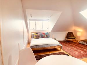 A bed or beds in a room at Camden Town House