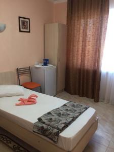 Кровать или кровати в номере Гостевой Дом Бриз