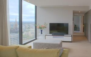 A television and/or entertainment center at Luxury at the Paris end of Collins st