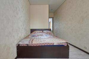 Кровать или кровати в номере Квартира на Площади Ленина