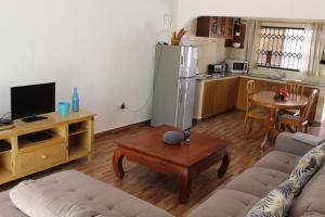 Телевизор и/или развлекательный центр в Farida Apartments
